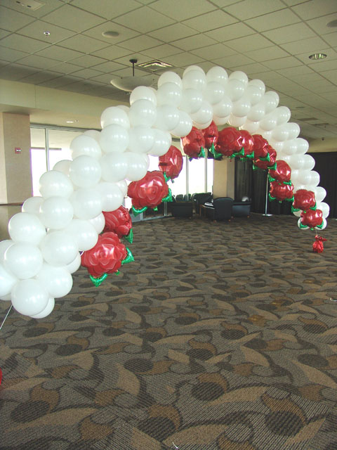 rose themed wedding balloon arch
